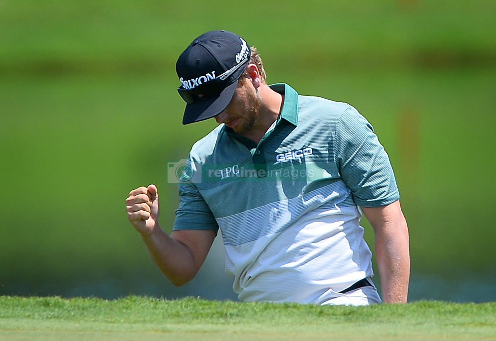 Chris Stroud pumps his fist after landing his ball near the pin after chipping onto the 17th green during first round action of the PGA Championship at Quail Hollow Club Thursday, Aug. 10, 2017 in Charlotte, N.C. (Photo by Jeff Siner/Charlotte Observer/TNS/Sipa USA)  *** Please Use Credit from Credit Field ***