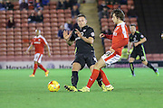 Barnsley midfielder, on loan from Manchester United, Ben Pearson  tackles York City midfielder James Barrett during the Johnstone's Paint Trophy match between Barnsley and York City at Oakwell, Barnsley, England on 10 November 2015. Photo by Simon Davies.