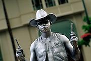 Image of a street entertainer on Kalakaua Avenue, Waikiki, Honolulu, Oahu, Hawaii, America West