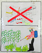 Community health poster warning farmworkers of the dangers of spraying crops with chemicals.<br /> The poster is in support a series of medical investigations into the high incidence of chronic renal failure in the region.<br /> <br /> 'Nefrolempa' project clinic, community of Nueva Esperanza, Bajo Lempa, El Salvador. 2011<br /> The 'Nefrolempa' research project is a collaboration between the El Salvador Ministry of Health, the Nephrology Institute of Cuba's Ministry for Public Health and the United Bajo Lempa Committee Association. The aim of the project is to investigate the reasons for the high levels of Chronic Kidney Disease (CKD) suffered by the communities within the Bajo Lempa region. It is exploring whether the use of agrochemicals might be a factor in the prevalence of the disease.