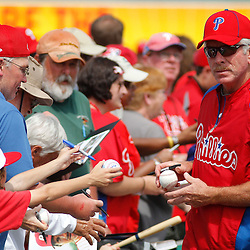 March 1, 2011; Clearwater, FL, USA; Former Philadelphia Phillies player Mike Schmidt signs autographs form fans before a spring training exhibition game against the Detroit Tigers at Bright House Networks Field  Mandatory Credit: Derick E. Hingle