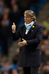 MANCHESTER, ENGLAND - Wednesday, March 24, 2010: Manchester City's manager Roberto Mancini during the Premiership match against Everton at the City of Manchester Stadium. (Photo by David Rawcliffe/Propaganda)