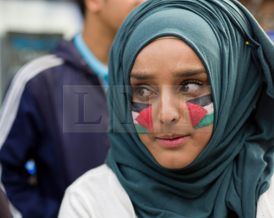 &copy; Licensed to London News Pictures. <br /> 23/07/2014. <br /> <br /> Middlesbrough, United Kingdom<br /> <br /> Members of the Teesside Palestine solidarity campaign group gathered in the centre of Middlesbrough to mount a peaceful demonstration to voice their opposition to the current Israeli actions in Gaza.<br /> <br /> Photo credit : Ian Forsyth/LNP