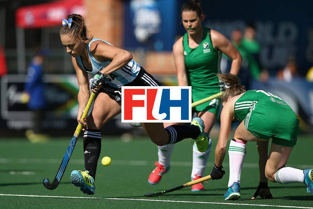 JOHANNESBURG, SOUTH AFRICA - JULY 18: Julieta Jankunas  of Argentina attempts to get past Emily Beatty of Ireland during the Quarter Final match between Argentina and Ireland during the FIH Hockey World League - Women's Semi Finals on July 18, 2017 in Johannesburg, South Africa.  (Photo by Jan Kruger/Getty Images for FIH)