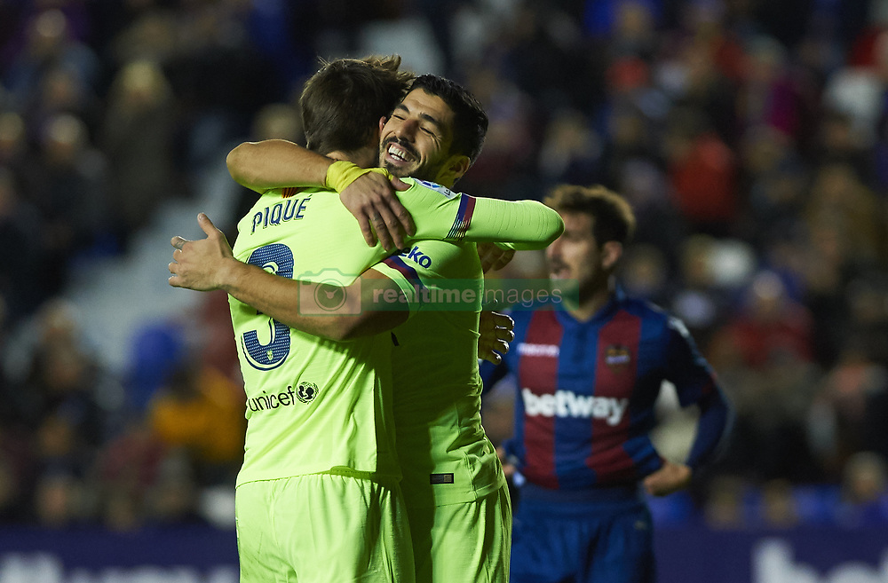 December 16, 2018 - Villarreal, Valencia, Spain - Gerard Pique and Luis Suarez of FC Barcelona celebrates a goal during the La Liga match between Levante UD and FC Barcelona at Ciutat de Valencia Stadium on December 16, 2018 in Valencia, Spain. (Credit Image: © Maria Jose Segovia/NurPhoto via ZUMA Press)