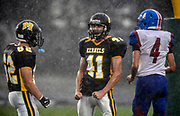 Mitchell's DJ Krogman (41) and Reed Foster (62) celebrate a safety by Douglas' Daniel Hand (4) during a game on Friday at Joe Quintal Field in Mitchell. (Matt Gade / Republic)