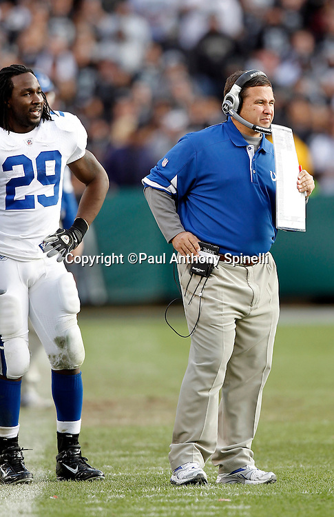 Indianapolis Colts running back Joseph Addai (29) looks on as Indianapolis Colts offensive coordinator Clyde Christensen calls a play while hiding his mouth with his play chart during the NFL week 16 football game against the Oakland Raiders on Sunday, December 26, 2010 in Oakland, California. The Colts won the game 31-26. (©Paul Anthony Spinelli)