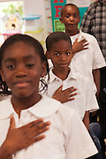 Bahamian school children pledge allegiance to the flag in New Plymouth on Green Turtle Cay, Bahamas.