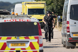 © Licensed to London News Pictures. 30/08/2016. Bognor Regis, UK. Armed police stand down after detaining a man who was held up in a house during an armed siege in Pagham. A 72 year old man had been in a stand-off with police since 4pm on Sunday.  Photo credit: Peter Macdiarmid/LNP