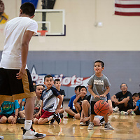 Camper Elijah Crane, 5, right, faces off against Jaythan Willie in a one on one drill, Wednesday, June 26 at Miyamura Kiddie Basketball Camp in Gallup.