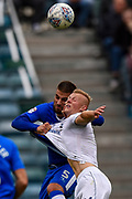Gillingham FC defender Max Ehmer (5) and Portsmouth forward Curtis Main (14) battle for the ball during the EFL Sky Bet League 1 match between Gillingham and Portsmouth at the MEMS Priestfield Stadium, Gillingham, England on 8 October 2017. Photo by Martin Cole.