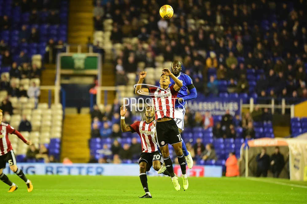 Birmingham City midfielder Cheikh N'Doye (17) heads the ball during the EFL Sky Bet Championship match between Birmingham City and Brentford at St Andrews, Birmingham, England on 1 November 2017. Photo by Dennis Goodwin.