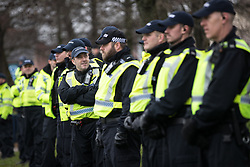 © Licensed to London News Pictures . 20/01/2018. Doncaster, UK. Hundreds of police separate the EDL and counter-protesters and protect the community . Far-right street protest movement , the English Defence League ( EDL ) , hold a demonstration , opposed by anti-fascists , including Unite Against Fascism ( UAF ) in the Hexthorpe area of Doncaster . EDL supporters chanted anti-Roma slogans as they marched through the town . Photo credit: Joel Goodman/LNP