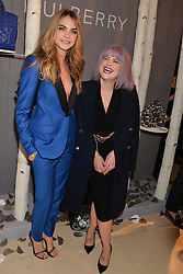 Left to right, CARA DELEVINGNE and KELLY OSBOURNE at a Dinner to celebrate the launch of the Mulberry Cara Delevingne Collection held at Claridge's, Brook Street, London on 16th February 2014.