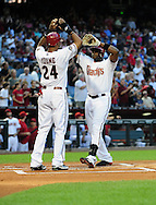 Apr. 29 2011; Phoenix, AZ, USA; Arizona Diamondbacks batter Justin Upton (right) is congratulated by teammate Chris Young (24) after hitting a two run home run during the first inning against the Chicago Cubs at Chase Field. Mandatory Credit: Jennifer Stewart-US PRESSWIRE.