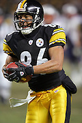 PITTSBURGH - JANUARY 23:  Wide receiver Hines Ward #86 of the Pittsburgh Steelers catches a 30 yard touchdown pass during the third quarter against the New England Patriots to close the gap to 14 points, giving the Steelers hope in the AFC Championship game at Heinz Field on January 23, 2005 in Pittsburgh, Pennsylvania. The Pats defeated the Steelers 41-27. ©Paul Anthony Spinelli  *** Local Caption *** Hines Ward
