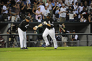 CHICAGO - JUNE 22:  Carlos Quentin #20 is greeted by third base coach Jeff Cox #6 of the Chicago White Sox after Quentin hit a three-run home run in the fourth inning against the Atlanta Braves on June 22, 2010 at U.S. Cellular Field in Chicago, Illinois.  The White Sox defeated the Braves 9-6.  (Photo by Ron Vesely)
