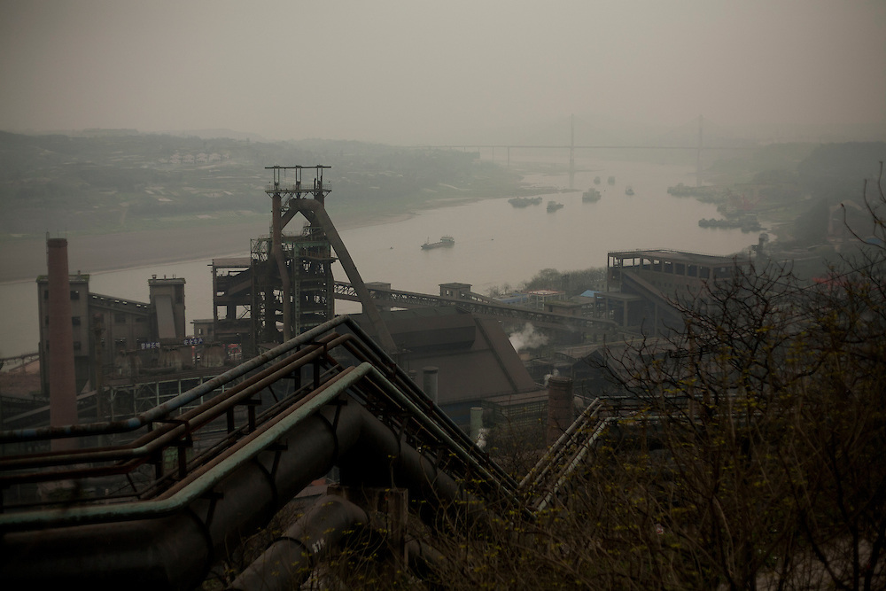 Chongqing city's major polluter, the Chongqing Steel Mill, belches smoke in an array of sooty yellow, brown, black and grey on Wednesday 21 March 2007.