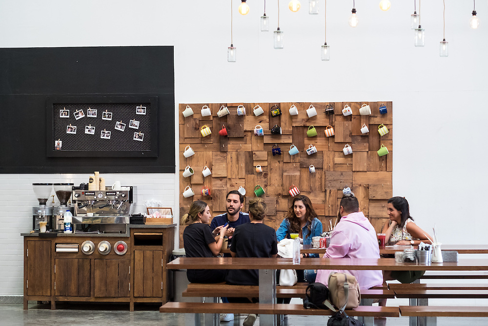 DUBAI, UAE - APRIL 30, 2016: The A4 is a two-storey, open seating collective space designed by Lebanese architect Fadi Sarieddine in Alserkal Avenue. The cafe, which offers beverages, salads and sandwiches is a meeting point for the creative community.