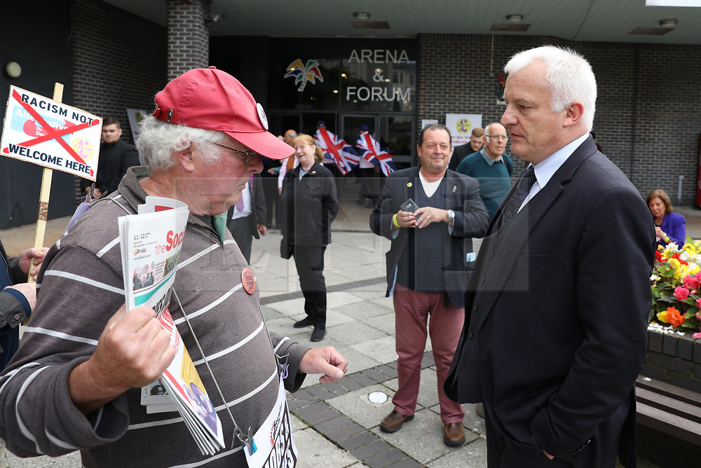 © Licensed to London News Pictures . 29/09/2017. Torquay, UK. Dr Hugh Bronson of the German AfD party arrives to speak at the conference surrounded by protesters . The UK Independence Party Conference at the Riviera International Centre . UKIP is due to announce the winner of a leadership election which has the potential to split the party . Photo credit: Joel Goodman/LNP