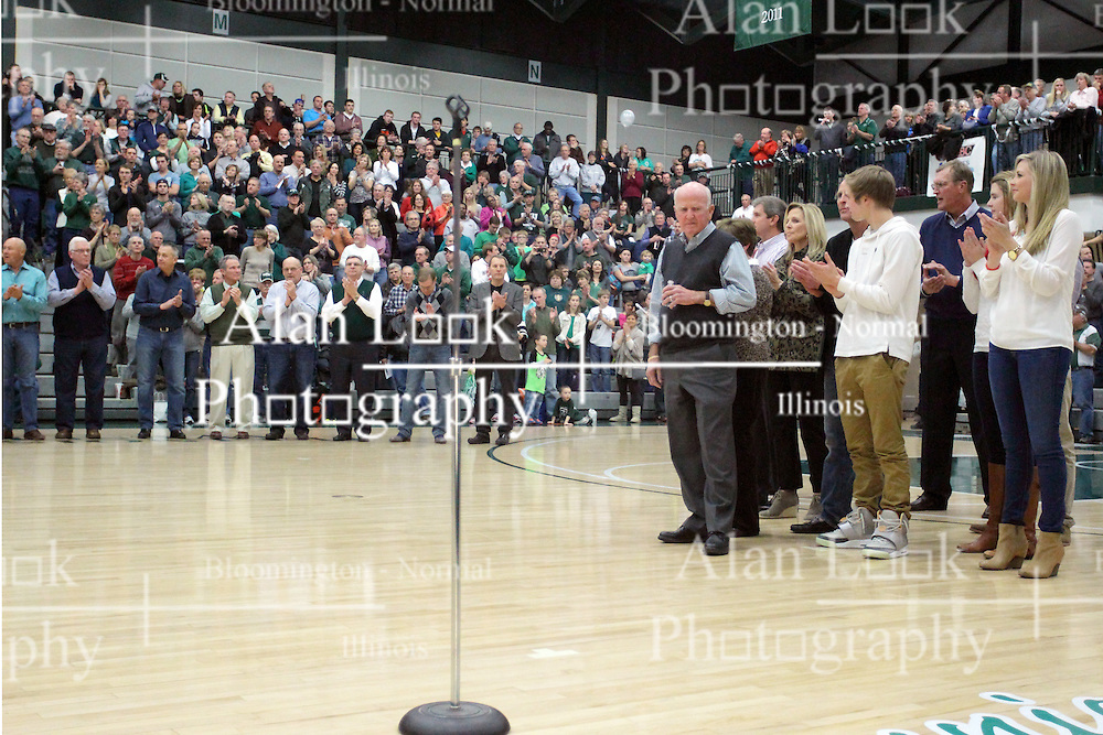 21 February 2015:  Dennie Bridges is joined by his family on the court.  At half time of an NCAA D# CCIW men's basketball game between the Illinois Wesleyan Titans in Shirk Center, Bloomington IL the floor was named in honor of retiring Dennie Bridges.  Dennie Bridges has been on the job at IWU for 51 years as a basketball coach, then athletic director.  Dennie is the 2nd winningest D3 coach by wins behind only Dick Saurs.  Dennie took the Titans to the D3 NCAA tournament 14 times in 18 season. He had a league record of 421-129 in 17 seasons.  Jack Sikma was a part of Dennie's 1973 recruiting class.  Sikma later played for the Milwaukee Bucks and Seattle Supersonics in the NBA.  IWU President Richard Wilson presided over the ceremony.