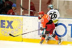 Kuralt Anze of HK Jesenice and Hiskey Rob of EHC Linz during ice-hockey match between HK Acroni Jesenice and EHC Liwest Black Wings Linz in 43rd Round of EBEL league, on Januar 17, 2012 at Dvorana Podmezaklja, Jesenice, Slovenia. (Photo By Urban Urbanc / Sportida)