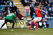 Coventry defender Jack Stephens shields the ball from Gillingham defender Ryan Jackson as Coventry goalkeeper Reice Charles-Cook collects the ball during the Sky Bet League 1 match between Gillingham and Coventry City at the MEMS Priestfield Stadium, Gillingham, England on 2 April 2016. Photo by David Charbit.