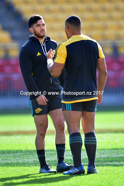 Hurricanes' Nehe Milner-Skudder (L) speaks with team mate Ngani Laumape during the Hurricanes captains run at Westpac Stadium in Wellington on Friday the 26th of June 2017. Copyright Photo by Marty Melville / www.Photosport.nz