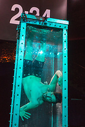 © Licensed to London News Pictures. 03/09/2015. London, UK. Andrew Basso performs a Houdini-style escape from a water tank. Press preview of the new magic show The Illusionists at Café de Paris, London. The touring magic show will open at London's Shaftesbury Theatre on 14 November 2015. Photo credit : Bettina Strenske/LNP