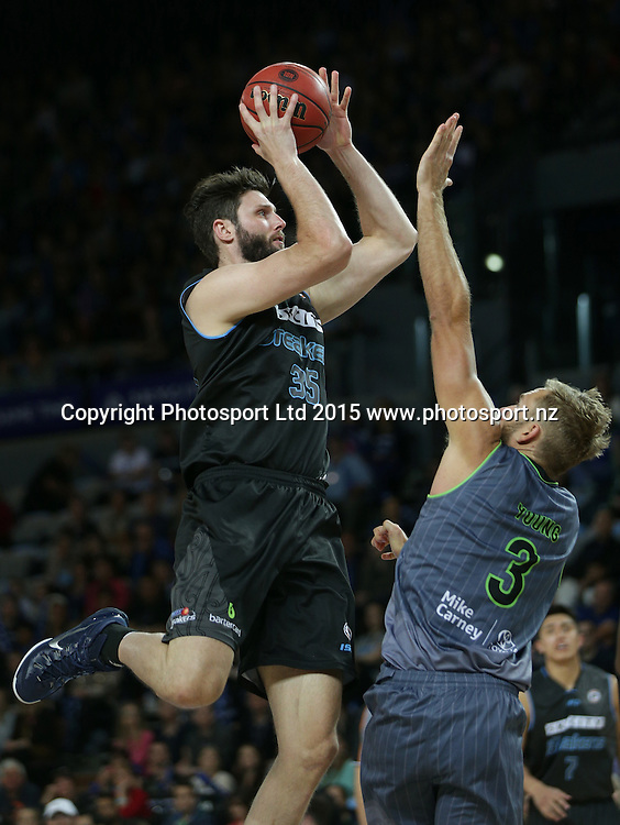 Breakers` Alex Pledger is challenged by Crocodiles' Mitchell Young in an ANBL Basketball Match, New Zealand Breakers v Townsville Crocodiles, Vector Arena, Auckland, New Zealand, Sunday, October 11, 2015. Copyright photo: David Rowland / www.photosport.nz