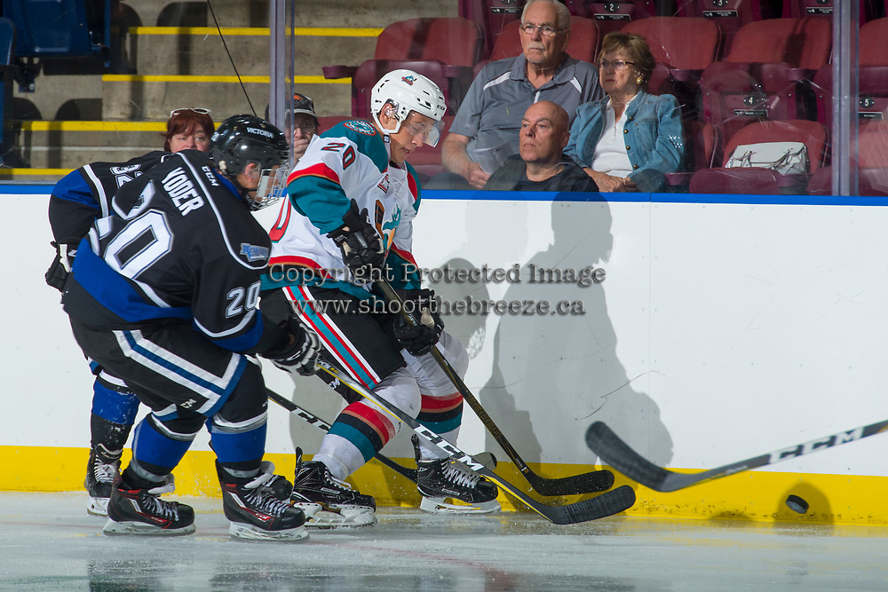 KELOWNA, CANADA - SEPTEMBER 2: Centre Ty Yoder #20 of the Victoria Royals checks left wing Conner Bruggen-Cate #20 of the Kelowna Rockets at the boards  on September 2, 2017 at Prospera Place in Kelowna, British Columbia, Canada.  (Photo by Marissa Baecker/Shoot the Breeze)  *** Local Caption ***