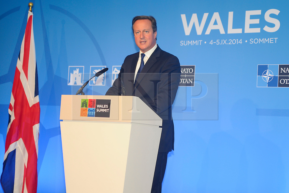 © London News Pictures. 05/09/2014. Newport, UK. <br /> British Prime Minister David Cameron speaking at the NATO (North Atlantic Treaty Organisation ) summit at Celtic Manor Resort, Newport, South Wales. Photo credit: Jeff Thomas/LNP