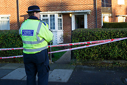 © licensed to London News Pictures. London, UK 29/12/2013. Police officers investigating death of an 18 year-old woman at a house on West Barnes Lane in New Malden, after she was found on fire near a level crossing. Officers believe the fire started at a nearby residential property and her death is being treated as unexplained. Photo credit: Tolga Akmen/LNP