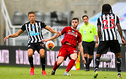 LIVERPOOL, ENGLAND - Sunday, July 26, 2020: Liverpool's Andy Robertson (R) and Newcastle United's Dwight Gayle during the final match of the FA Premier League season between Newcastle United FC and Liverpool FC at St. James' Park. The game was played behind closed doors due to the UK government's social distancing laws during the Coronavirus COVID-19 Pandemic. Liverpool won 3-1 and finished the season as Champions on 99 points. (Pic by Propaganda)