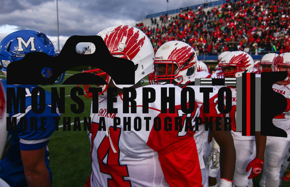 Players shake hands at the center of the field after Smyrna (12-0) defeated Top-seeded Middletown (11-1) 36-14 Saturday, Dec. 03, 2016 at Delaware Stadium in Newark.