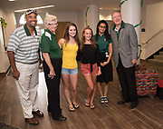 Jason Pina, Vice President for Student Affairs (Left) and President Duane Nellis and First Lady Ruthie Nellis pose for a photo with students during move- in Thursday morning. Photo by Ben Siegel