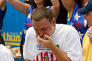 NEW YORK, NY-06 JUL04-- American favourite Joey Chestnut appears to have difficulty as the hot dog eating competition comes to a close. (Extra) The Gazette/Liam Maloney