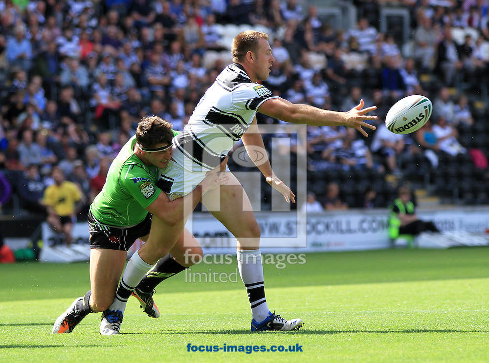 Picture by Richard Gould/Focus Images Ltd. 07710 761829.29/07/12.Liam Watts of Hull FC off loads with Luke Adams of Salford hodling on during the Stobart Super League match at KC Stadium, Hull.