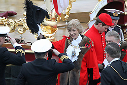 © Licensed to London News Pictures. 09/11/2013. The new Lord Mayor of the City of London has been carried along the Thames on board the Queen's row barge Gloriana. The vessel was accompanied by a flotilla of river craft as it transited through Tower Bridge and then the new mayor Fiona Woolf - only the second female to have the position in its 800 year history - disembarked the row barge and at HMS President she inspected Royal Navy reservists and took part in a historic Rum Ceremony. The annual Lord Mayor's show will continue around the streets of the Square Mile. Credit : Rob Powell/LNP