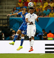 Daniel Sturridge of England and Gabriel Paletta of Italy during the 2014 FIFA World Cup match at Arena da Amazonia, Manaus<br /> Picture by Andrew Tobin/Focus Images Ltd +44 7710 761829<br /> 14/06/2014