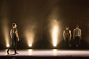 """A foggy scene in """"Night Box"""" by Wen Wei Wang. The set and costumes were in shades of  gray and black."""