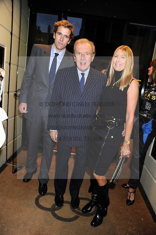 Left to right, WILFRED FROST and his parents SIR DAVID & LADY CARINA FROST at a party hosted by Links of London to launch their new Driver Chicane Chronograph Watch held at Lonks, Sloane Square, London on 24th September 2008.