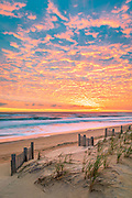 A beautiful sunrise over Kitty Hawk Beach on the Outer Banks of NC.