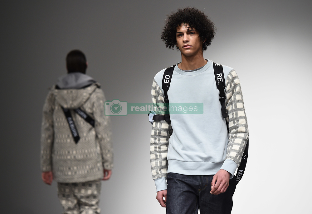 Models on the catwalk during the Christopher Raeburn London Fashion Week Men's AW18 show, held at the BFC Show space, London. Picture date: Sunday January 7th, 2018. Photo credit should read: Matt Crossick/ EMPICS Entertainment.