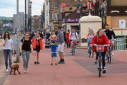 Portobello, Scotland, UK. 9 May 2020. Images from holiday weekend Saturday afternoon during Covid-19 lockdown on promenade at Portobello. Promenade and beach were relatively quiet with a low key police presence. Pictured;  Sections of promenade busy with cyclists and pedestrians. Iain Masterton/Alamy Live News