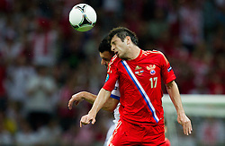 Giorgos Tzavellas  of Greece vs Alan Dzagoev of Russia during the UEFA EURO 2012 group A match between  Greece and Russia at The National Stadium on June 16, 2012 in Warsaw, Poland.  (Photo by Vid Ponikvar / Sportida.com)