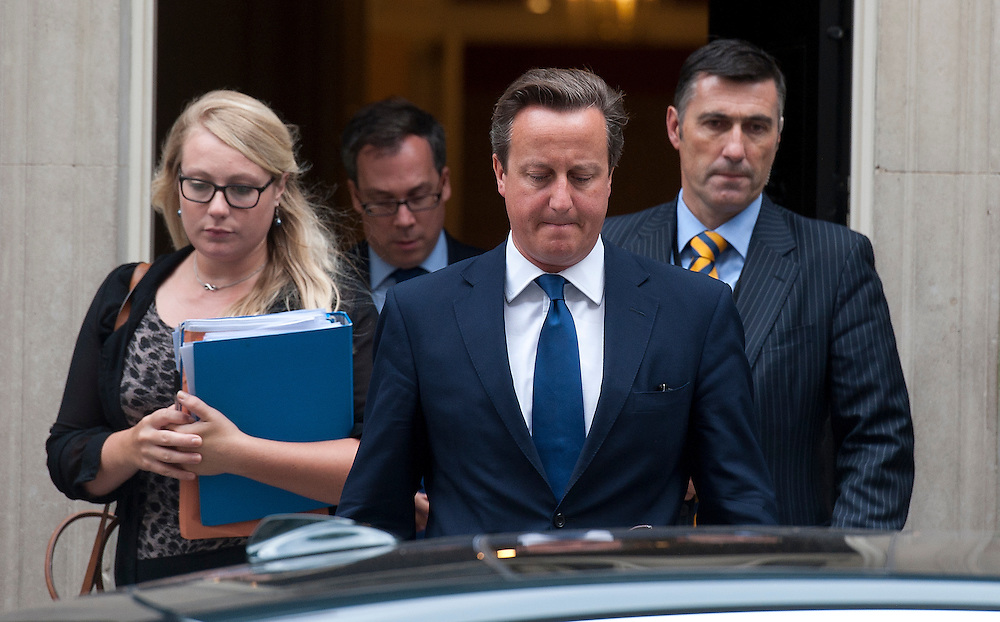 British Prime Minister David Cameron (centre) leaves number 10 Downing Street in central London, England, 03September 2014. Earlier this morning the British Government hosted a COBRA meeting to discuss the latest situation in Iraq.