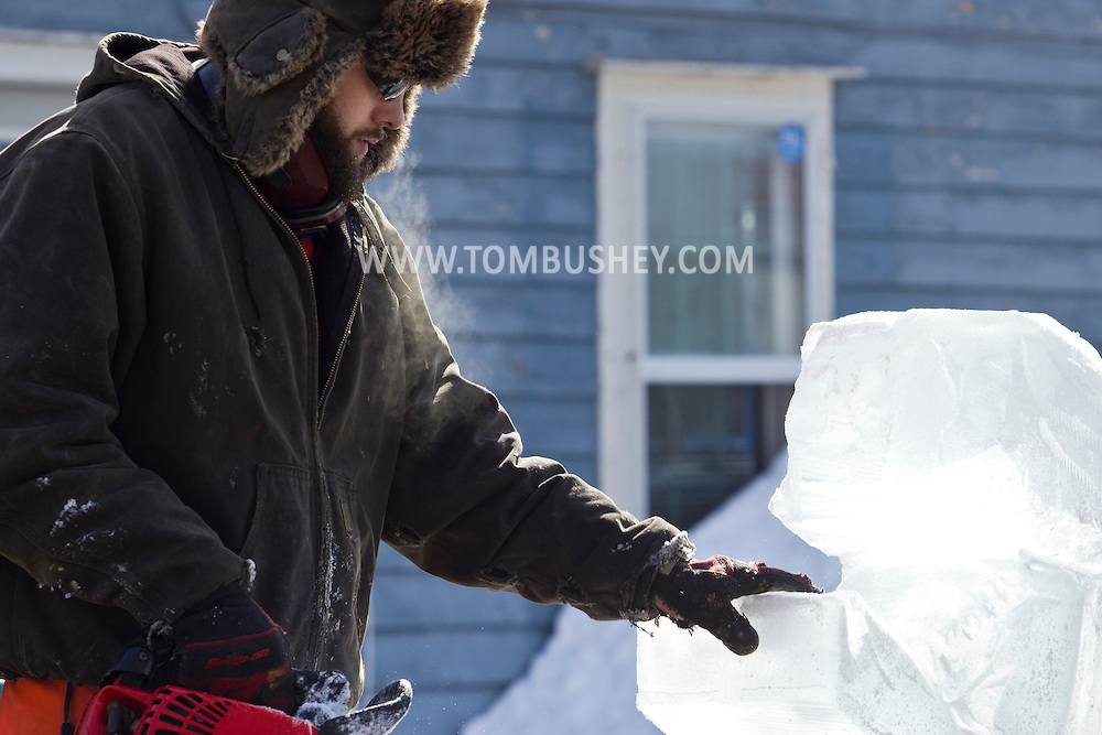 "Wurtsboro, New York - Ice carver Jake Polick works on his sculpture during a contest at the Winterfest on Feb. 8, 2014. Polick's sculpture ""Hopefull Mermaid"" won third place. The festival is sponsored and organized by the Wurtsboro Board of Trade."