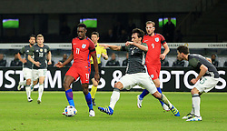 Englands Danny Welbeck is tackled by Germanys Mats Hummels - Mandatory by-line: Matt McNulty/JMP - 26/03/2016 - FOOTBALL - Olympiastadion - Berlin, Germany - Germany v England - International Friendly