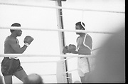 Ali vs Lewis Fight, Croke Park,Dublin.<br /> 1972.<br /> 19.07.1972.<br /> 07.19.1972.<br /> 19th July 1972.<br /> As part of his built up for a World Championship attempt against the current champion, 'Smokin' Joe Frazier,Muhammad Ali fought Al 'Blue' Lewis at Croke Park,Dublin,Ireland. Muhammad Ali won the fight with a TKO when the fight was stopped in the eleventh round.<br /> <br /> Image of Lewis on the offensive against Ali.